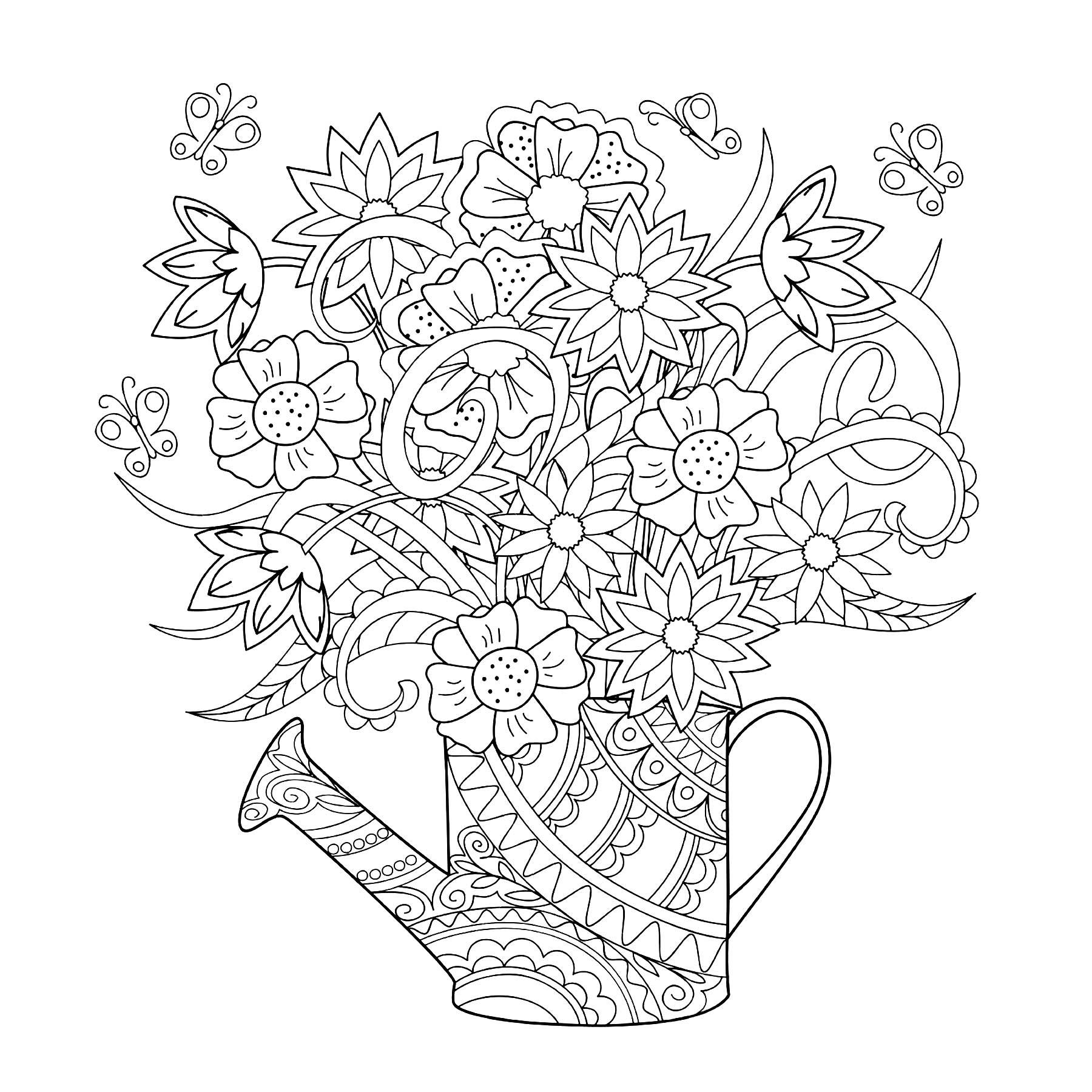 Un bel arrosoir dans lequel des fleurs ont poussé