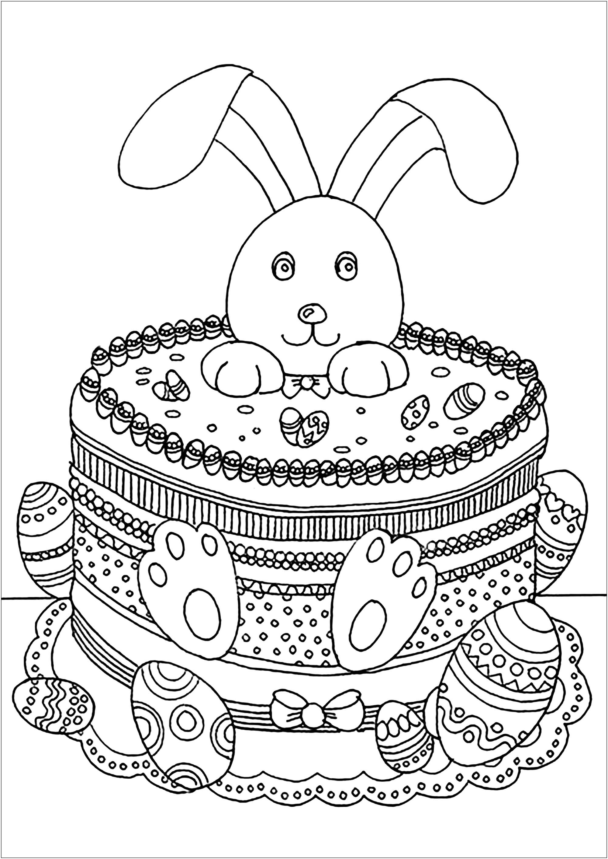 Joli lapin de Pâques dans un gâteau, plein de jolis oeufs à colorier