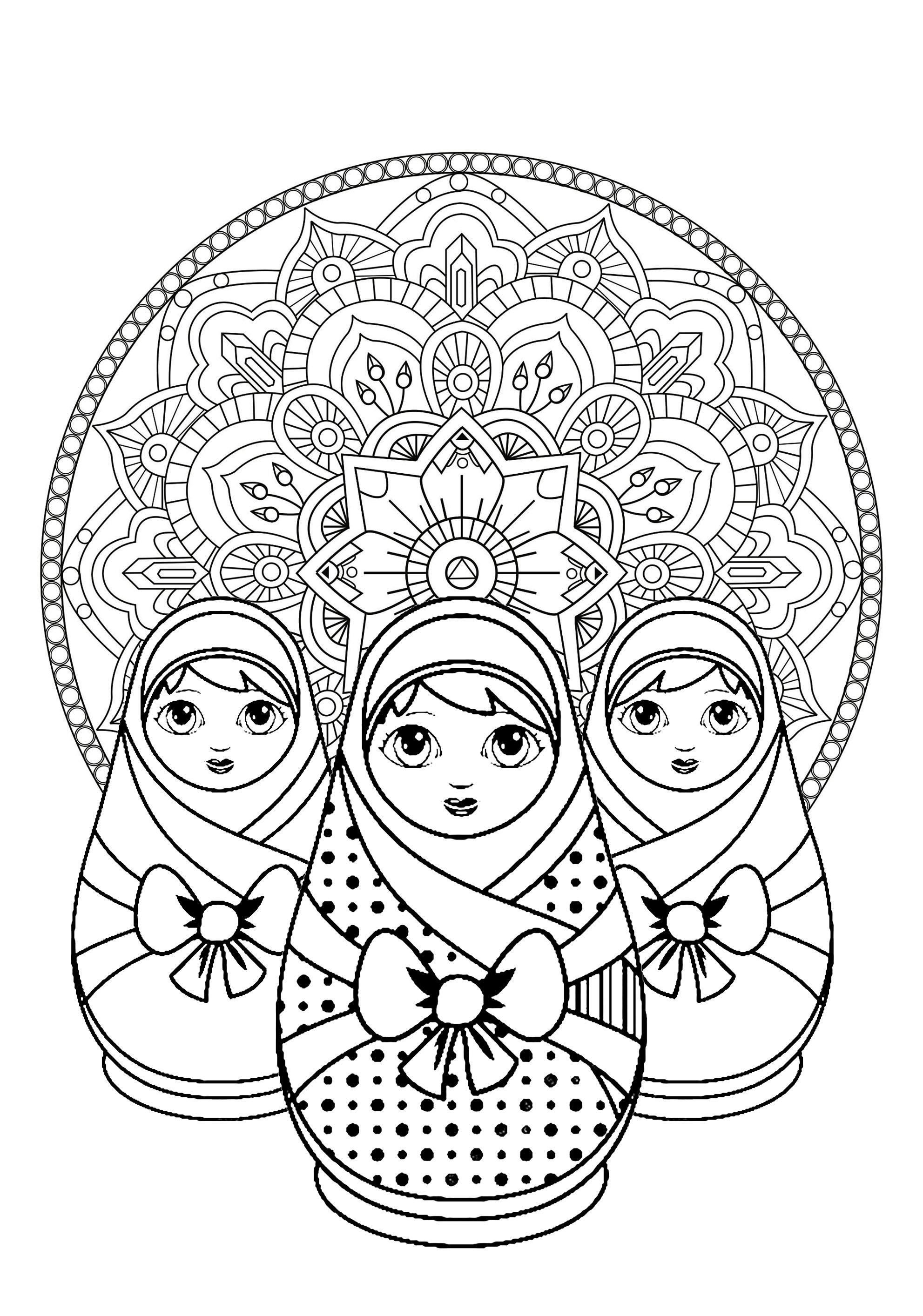 Trois jolies poupées russes et un beau Mandala en arrière plan