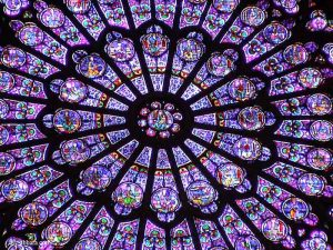 Stained glass windows, rosette of the north transept, Cathedral of Notre-Dame de Paris, France.