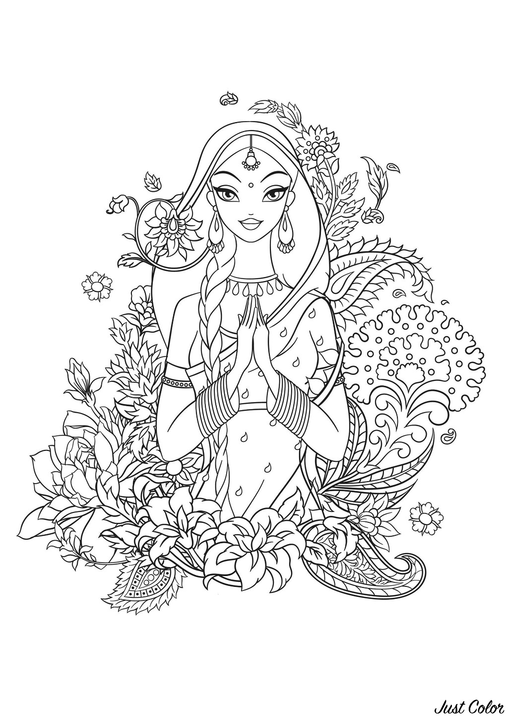 Indian girl in sari surrounded with flowers and traditional indian ornaments