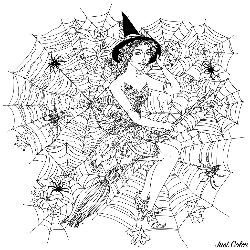 Beautiful woman looking like a witch with cobwebs, spiders and other decorations on halloween